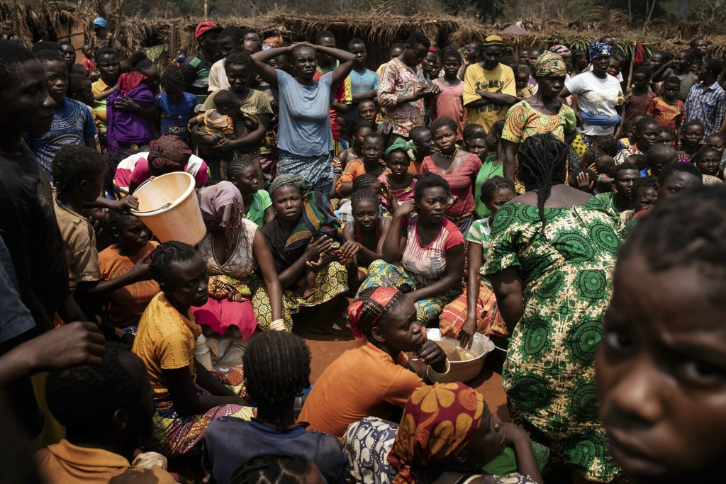 Displaced people who fled Bangassou wait for food distribution in the village where they found refuge, Siwa, Central African Republic, Saturday Feb. 1...