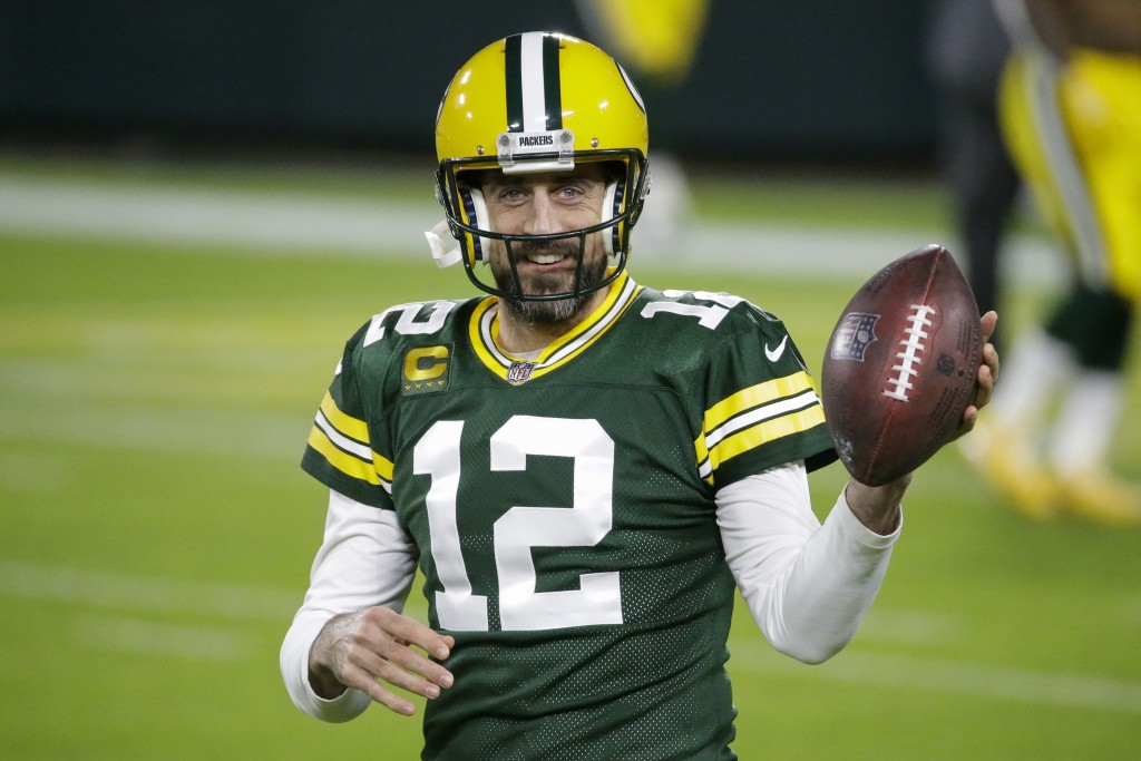 FILE - Green Bay Packers' Aaron Rodgers warms up before an NFL football game against the Chicago Bears in Green Bay, Wis., in this Sunday, Nov. 29, 20...