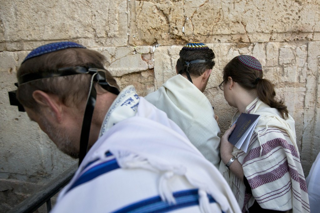 FILE - In this Feb. 25, 2016 file photo, American and Israeli Reform rabbis pray at the Western Wall, the holiest site where Jews can pray in Jerusale...