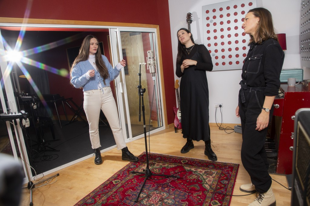 Members of the folk group The Staves, sisters, from left, Camilla, Jessica and Emily Staveley-Taylor rehearse a song in a north London recording studi...