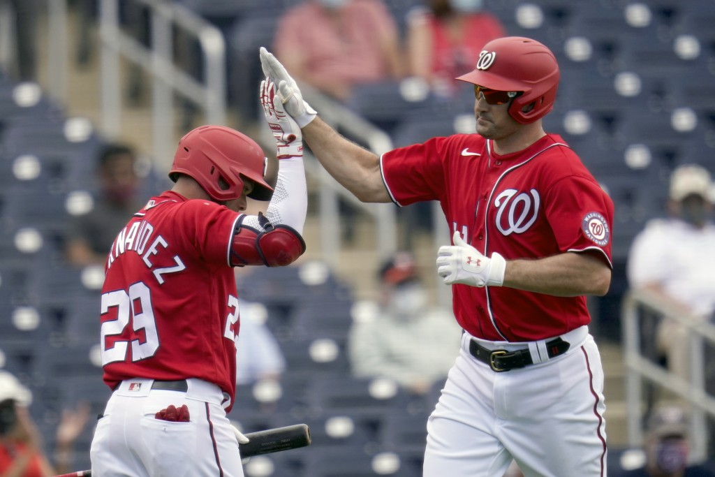 Washington Nationals' Ryan Zimmerman, right, is congratulated by teammate Yadiel Hernandez after hitting a solo home run during the third inning of a ...