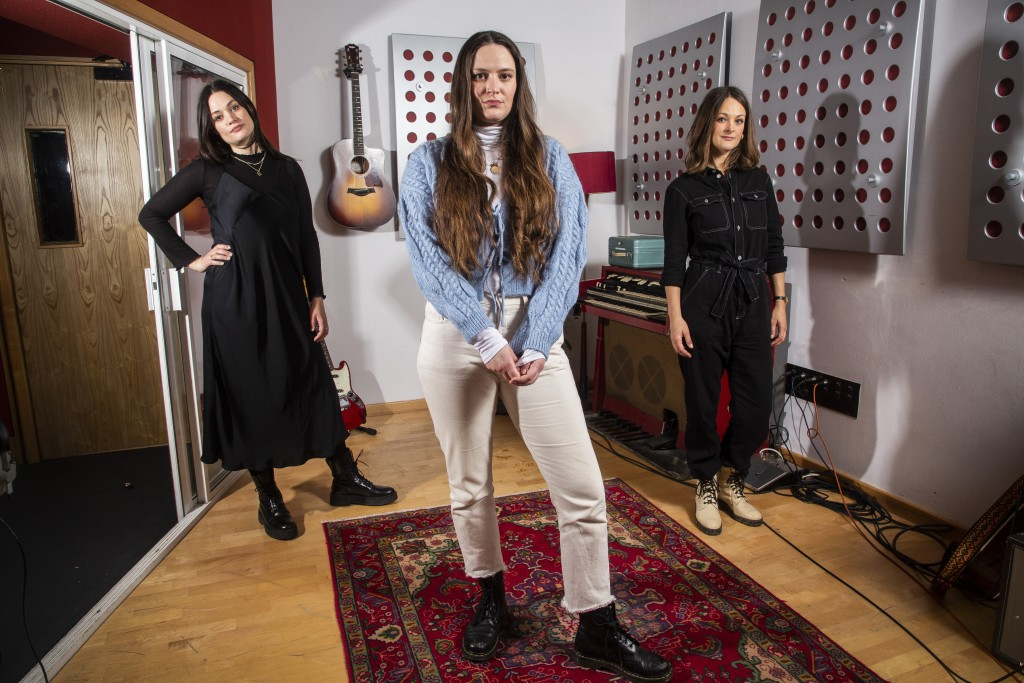 Members of the folk group The Staves, sisters, from left, Jessica, Camilla and Emily Staveley-Taylor pose in a north London recording studio to promot...