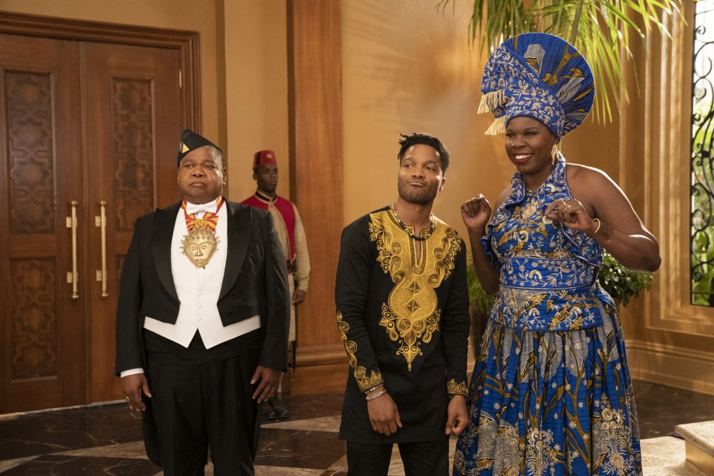 "Paul Bates, from left, Leslie Jones and Jermaine Fowler appear in a scene from ""Coming 2 America."" (Quantrell D. Colbert/Paramount Pictures via AP)"