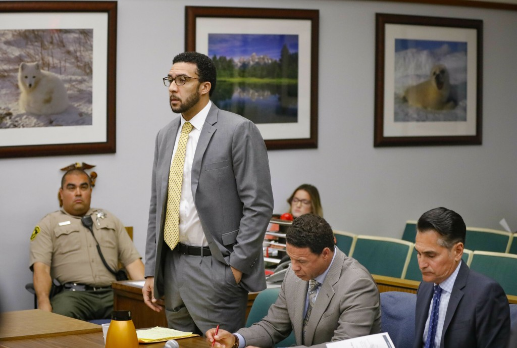 FILE - In this June 14, 2019 file photo Ex-NFL player Kellen Winslow II, standing, who was accused of committing several sex crimes against women in N...