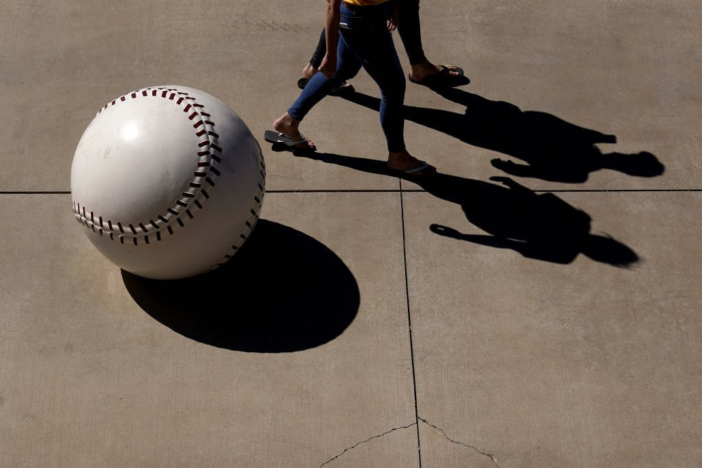 People enter Peoria Sports Complex before a spring training baseball game between the San Diego Padres and the Chicago Cubs, Monday, March 1, 2021, in...