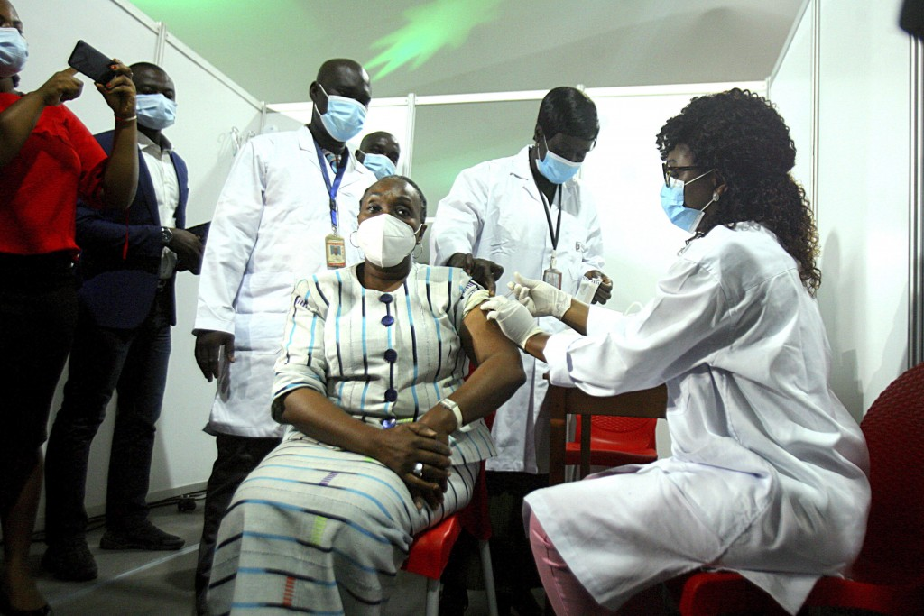 Raimonde Goudou Coffie , culture minister, receives a shot of the AstraZeneca vaccine in Abidjan, Ivory Coast, Monday March 1, 2021. Ivory Coast is th...