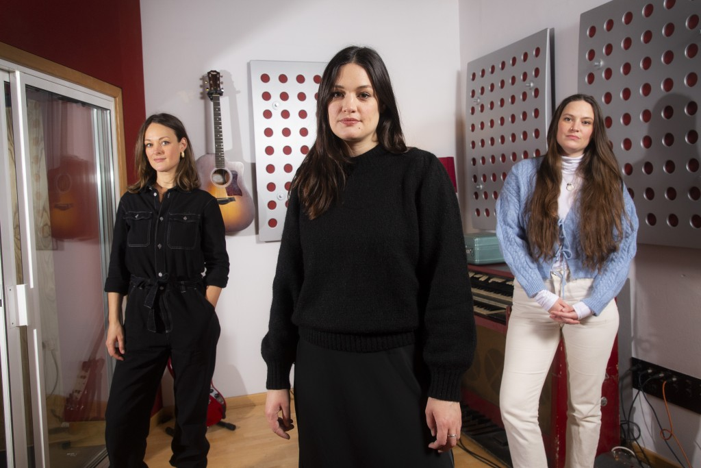 Folk group, The Staves, from left, sisters, Emily, Jessica and Camilla Staveley-Taylor pose in a north London recording studio to promote their album ...