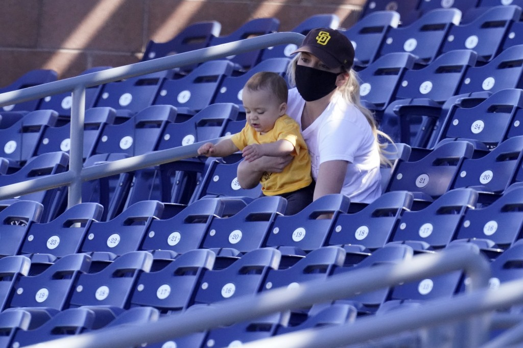A San Diego Padres fan watches the second inning of a spring training baseball game against the Chicago Cubs, Monday, March 1, 2021, in Peoria, Ariz. ...
