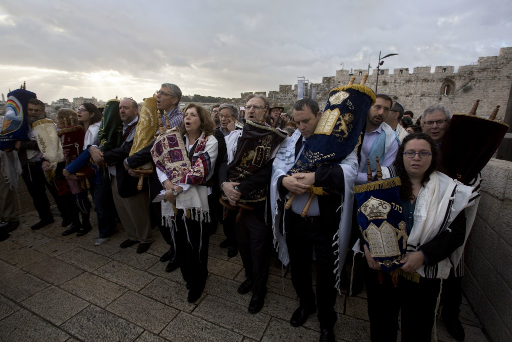 FILE - In this Nov. 2, 2016 file photo, the heads of the Jewish Reform and Conservative movements carry Torah scrolls as they march to the Western Wal...