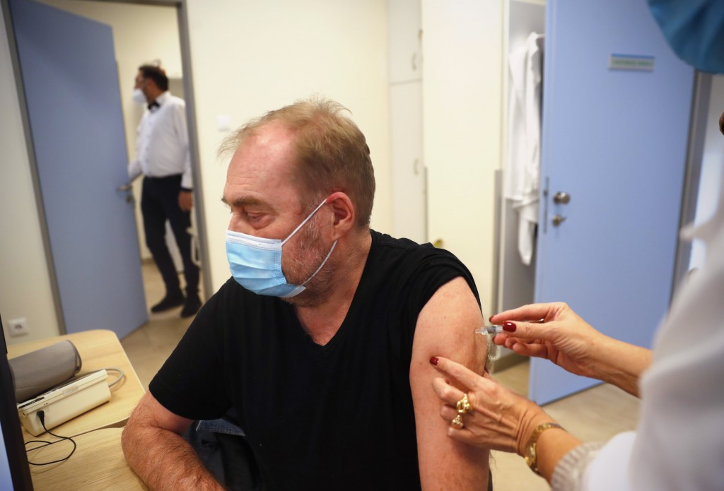 A man receives a Chinese made Sinopharm COVID-19 vaccine in Budapest, Hungary on Wednesday, Feb. 24, 2021. China is providing the vaccine to countries...