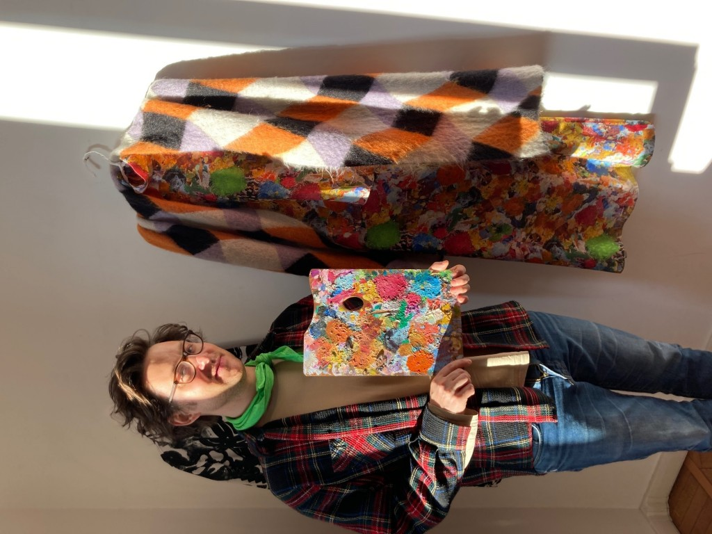 Milan-based Austrian fashion designer Arthur Arbesser, poses in his studio holding a painter's pallet that he picked up at a flea market, and which in...
