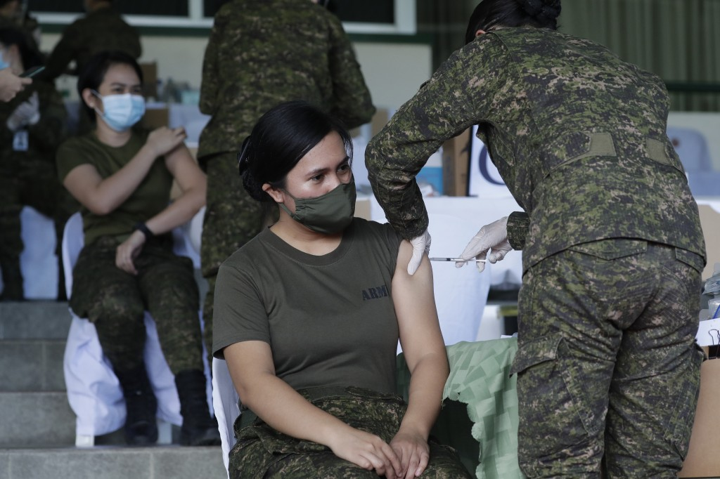 Philippine Army women soldiers are injected with the Sinovac vaccine from China during a vaccination at Fort Bonifacio, Metro Manila, Philippines on T...