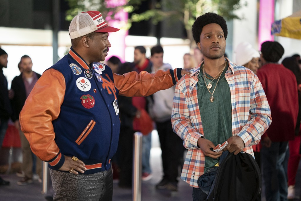 "Eddie Murphy, left, and Jermaine Fowler appear in a scene from ""Coming 2 America."" (Quantrell D. Colbert/Paramount Pictures via AP)"