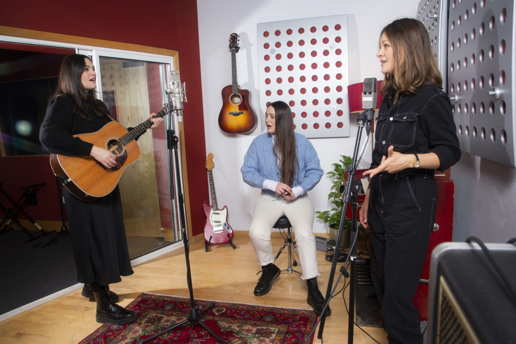 Members of the folk group, The Staves, from left, sisters, Jessica, Camilla and Emily Staveley-Taylor rehearse in a north London recording studio, on ...