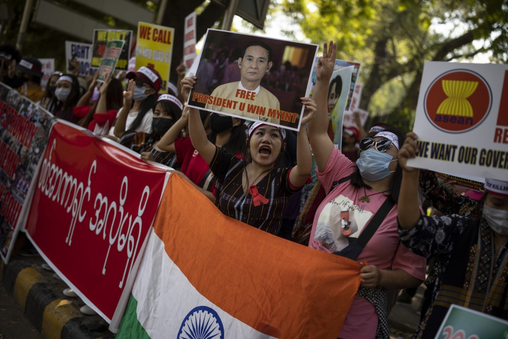 Chin refugees from Myanmar shout slogans during a protest against military coup in Myanmar, in New Delhi, India, Wednesday, March 3, 2021. (AP Photo/A...