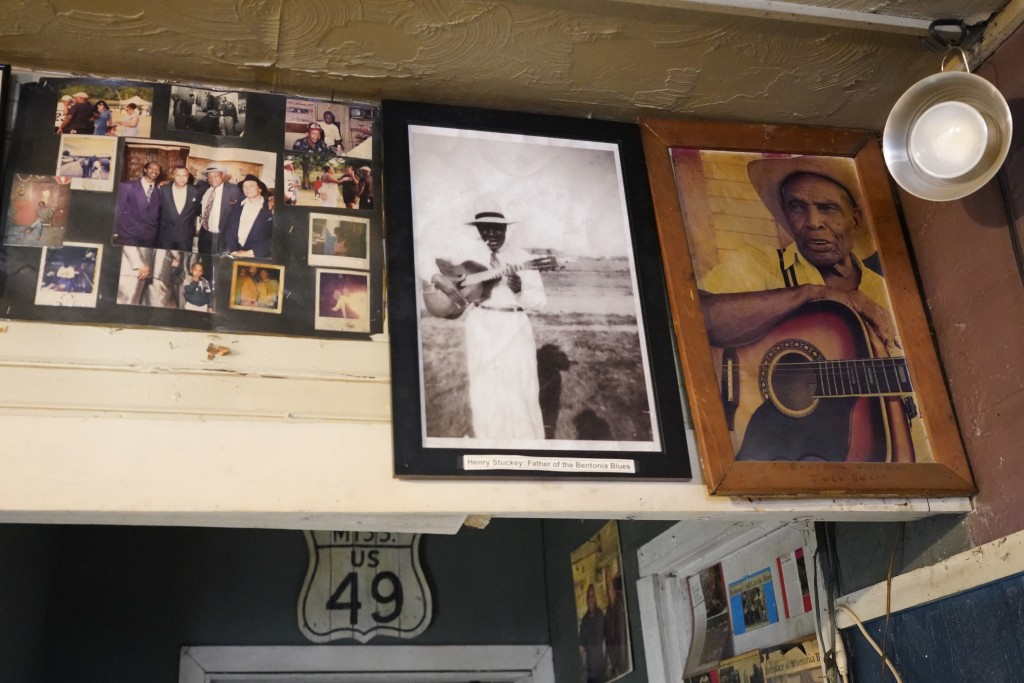 Portraits of Henry Stuckey, the originator of the Bentonia blues, second from right, and area resident and bluesman Jack Owens, hang high on the wall ...