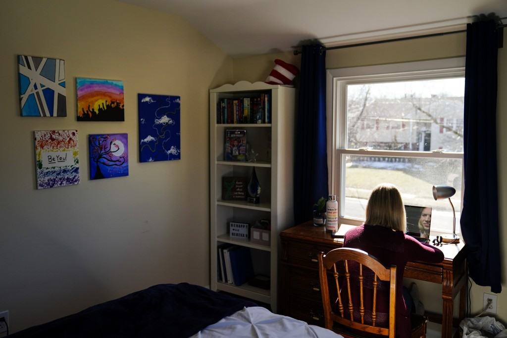 Rebekah Bruesehoff, 14, works on school assignments at home in Cherry Hill, N.J., Friday, Feb. 26, 2021. While New Jersey has a trans-inclusive sports...
