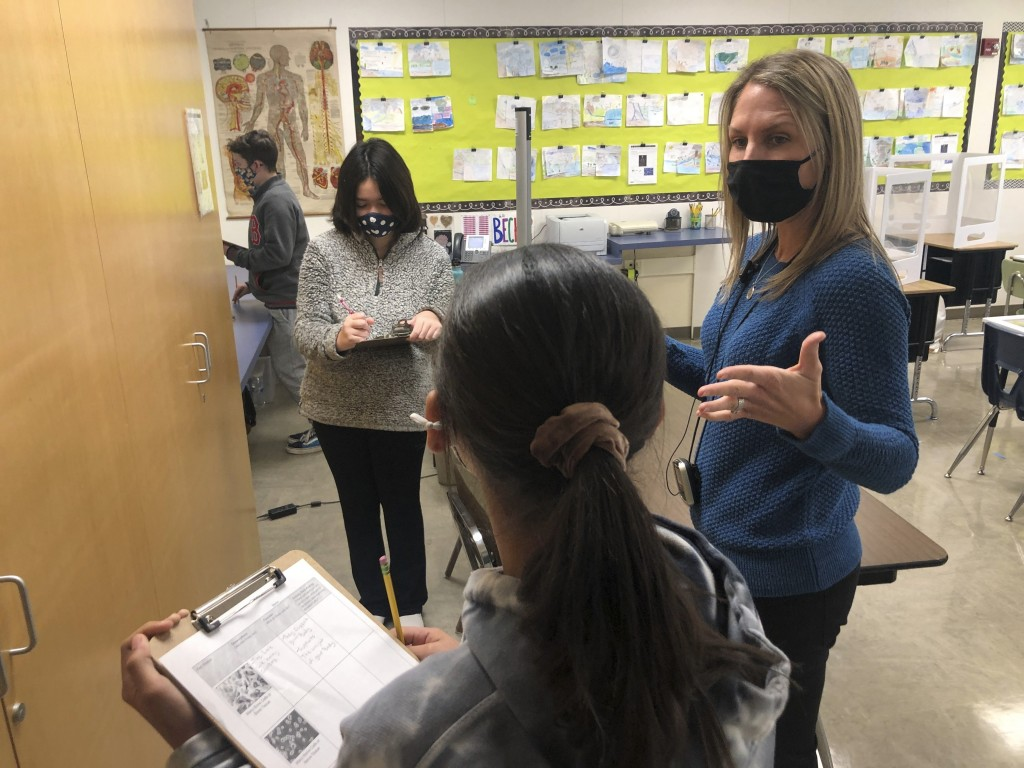 Jennifer Becker, right, Science Teacher at the Sinaloa Middle School, talks to one of her students in Novato, Calif. on Tuesday, March 2, 2021. The sc...