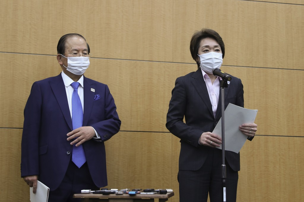Seiko Hashimoto, right, president of the Tokyo Organizing Committee of the Olympic and Paralympic Games (Tokyo 2020), speaks as Toshiro Muto, CEO of T...
