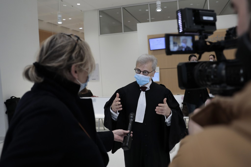 Plaintiffs lawyer Christophe Leguevaques answers reporters before the start of a hearing at the Paris palace of Justice, Wednesday, March 3, 2021. A P...