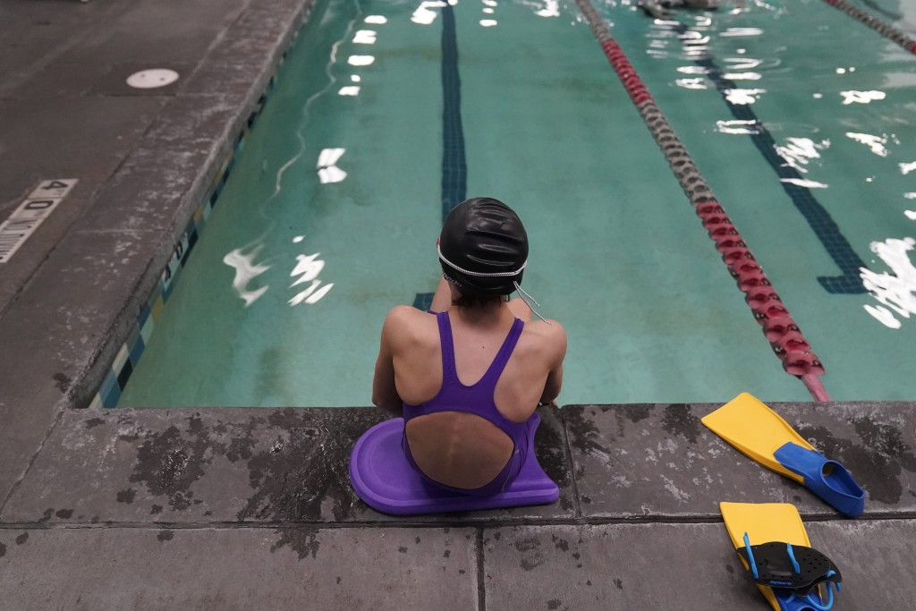 A proposed ban on transgender athletes playing female school sports in Utah would affect transgender girls like this 12-year-old swimmer seen at a poo...