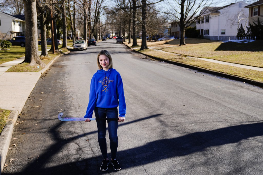 Rebekah Bruesehoff, 14, poses for a portrait in Cherry Hill, N.J., Friday, Feb. 26, 2021. The transgender teenager competes on her middle school field...