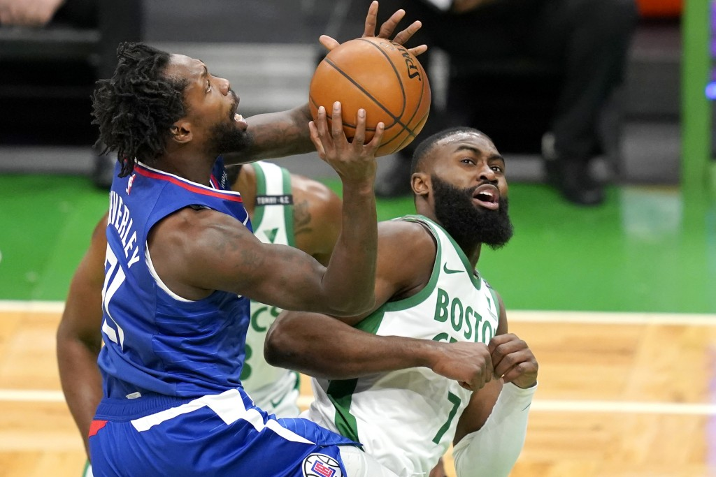 LA Clippers guard Patrick Beverley (21) drives to the hoop against Boston Celtics guard Jaylen Brown (7) in the first quarter of an NBA basketball gam...