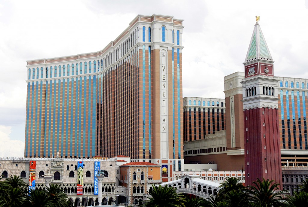 FILE - This Aug. 2, 2005 file photo shows the Venetian Hotel and Casino on the Las Vegas Strip. Las Vegas Sands is selling the real estate and operati...