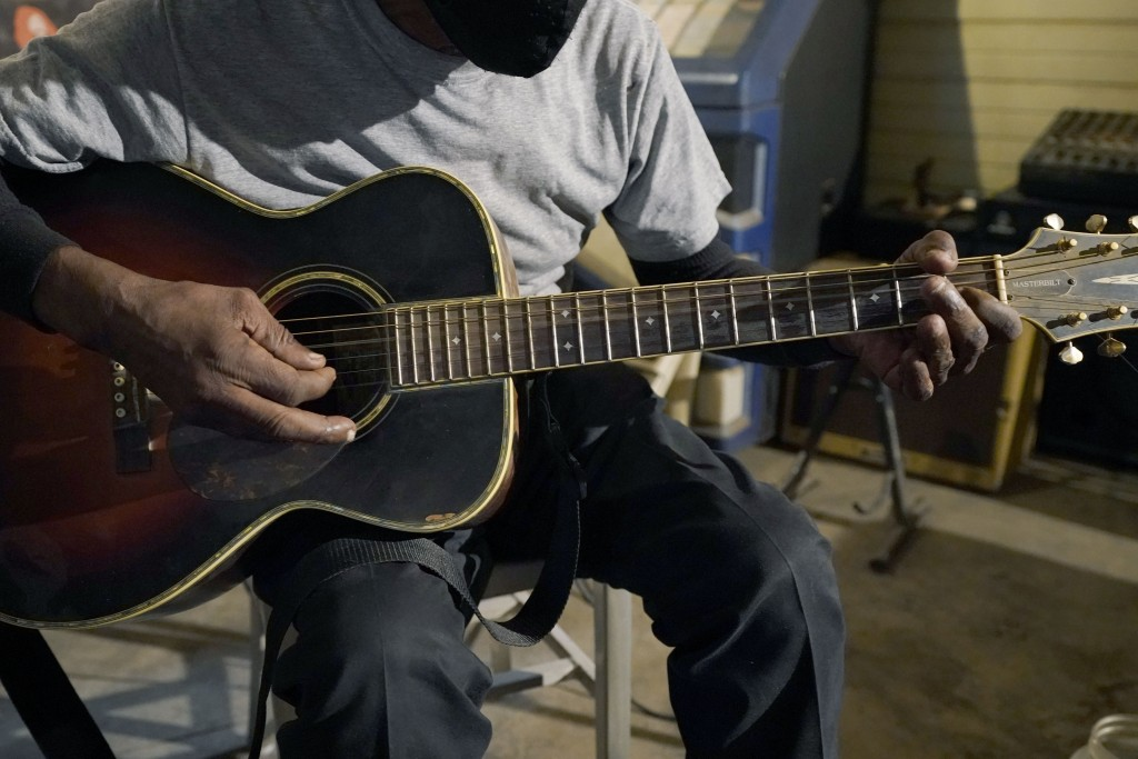 """Blues performer Jimmy """"Duck"""" Holmes plays a quick ditty at the Blue Front Cafe in Bentonia, Miss., Jan. 21, 2021. Holmes' ninth album, """"Cypress Grove,..."""