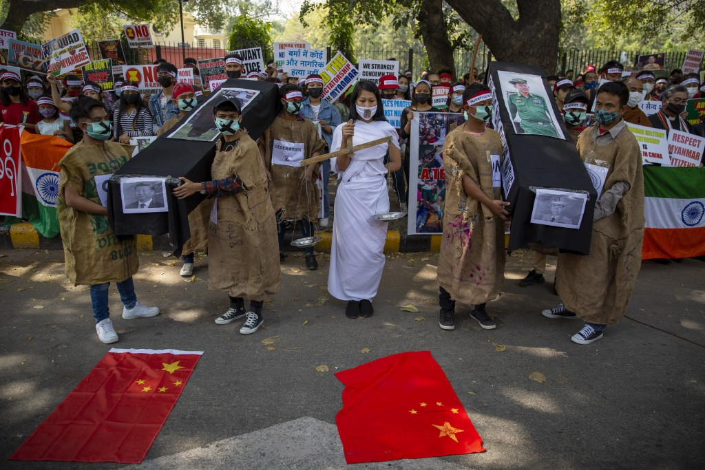 Chin refugees from Myanmar carry mock coffins of Commander in chief, Senior Gen. Min Aung Hlaing and Chinese President Xi Jinping during a protest aga...
