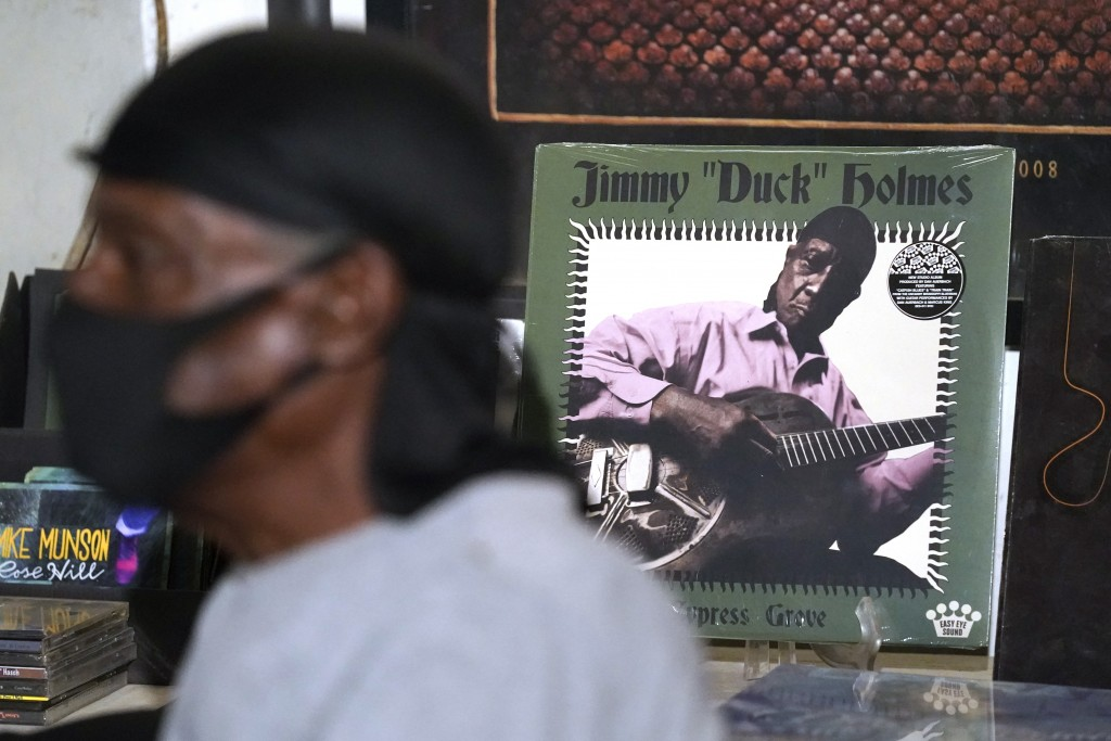 """An album cover featuring the portrait of blues performer Jimmy """"Duck"""" Holmes peers behind the bluesman as he talks of the area musicians from whom he ..."""