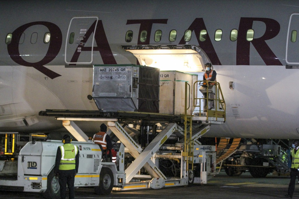 The first arrival of COVID-19 vaccines to Kenya is offloaded from a Qatar Airways flight at Jomo Kenyatta International Airport in Nairobi, Kenya, ear...
