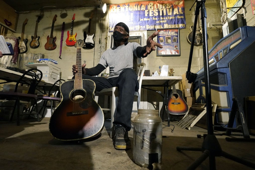 """Bluesman Jimmy """"Duck"""" Holmes gestures as he speaks of the area musicians he learned the style of the Bentonia Blues from at his Blue Front Cafe in Ben..."""