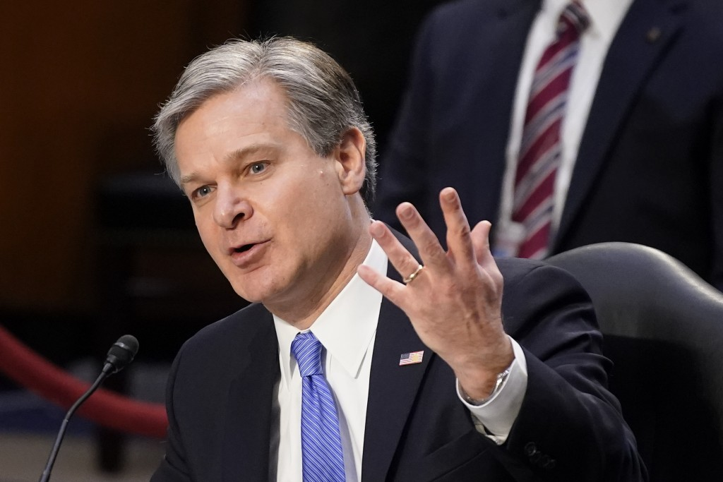 FBI Director Christopher Wray testifies before the Senate Judiciary Committee on Capitol Hill in Washington, Tuesday, March 2, 2021. Wray is condemnin...