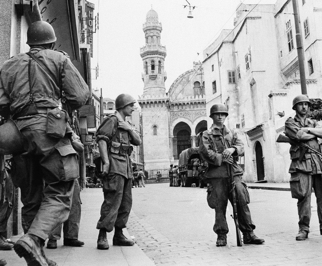 FILE - In this May 27, 1956 file photo, French troops seal off Algiers' notorious casbah, 400-year-old teeming Arab quarter. French President Emmanuel...