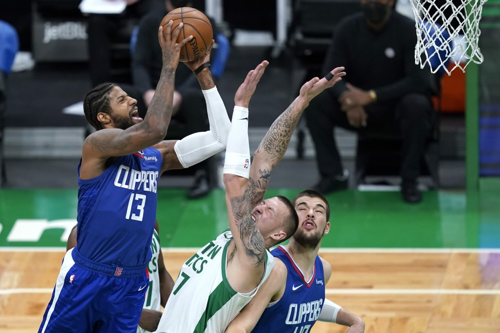 Los Angeles Clippers guard Paul George (13) shoots against Boston Celtics center Daniel Theis (27) as Clippers center Ivica Zubac (40) looks on in the...