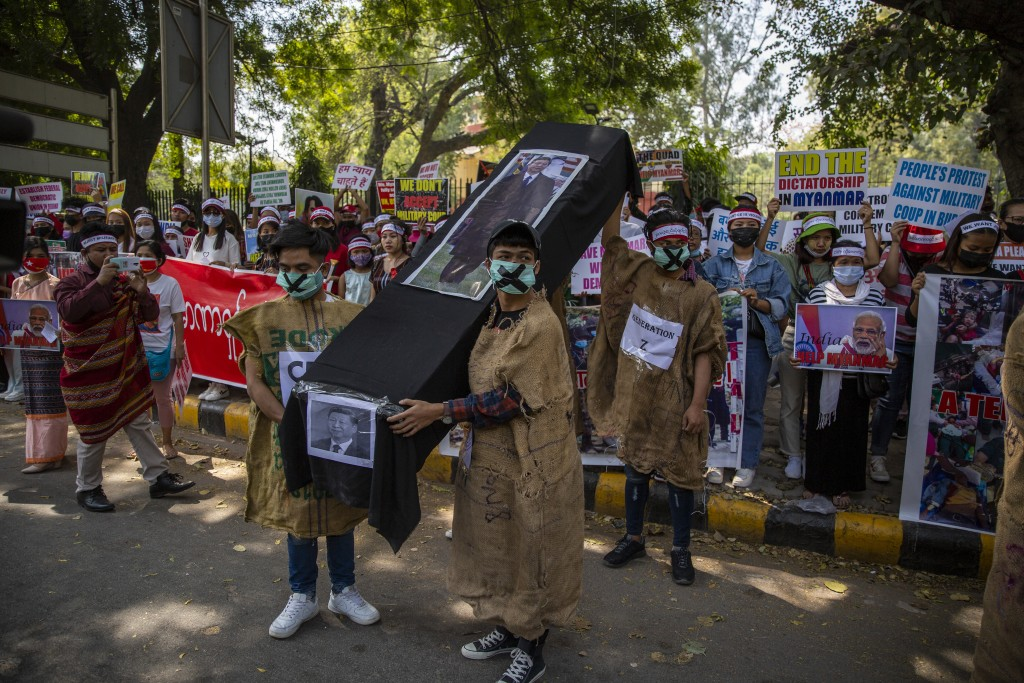 Chin refugees from Myanmar carries a mock coffin of Chinese President Xi Jinping during a protest against military coup in Myanmar, in New Delhi, Indi...