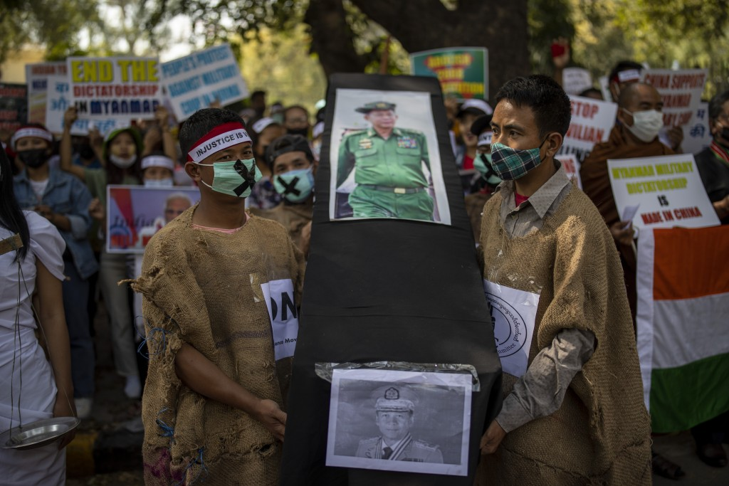 Chin refugees from Myanmar carry a mock coffins of Commander in chief, Senior Gen. Min Aung Hlaing during a protest against military coup in Myanmar, ...