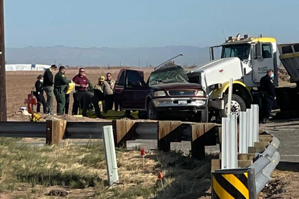 In this image from KYMA law enforcement work at the scene of a deadly crash involving a semitruck and an SUV in Holtville, Calif., on Tuesday, March 2...