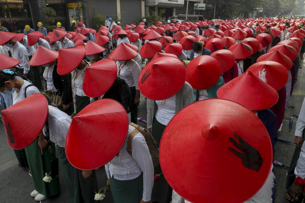 Anti-coup school teachers in their uniform and traditional Myanmar-hats participate in a demonstration in Mandalay, Myanmar, Wednesday, March 3, 2021....