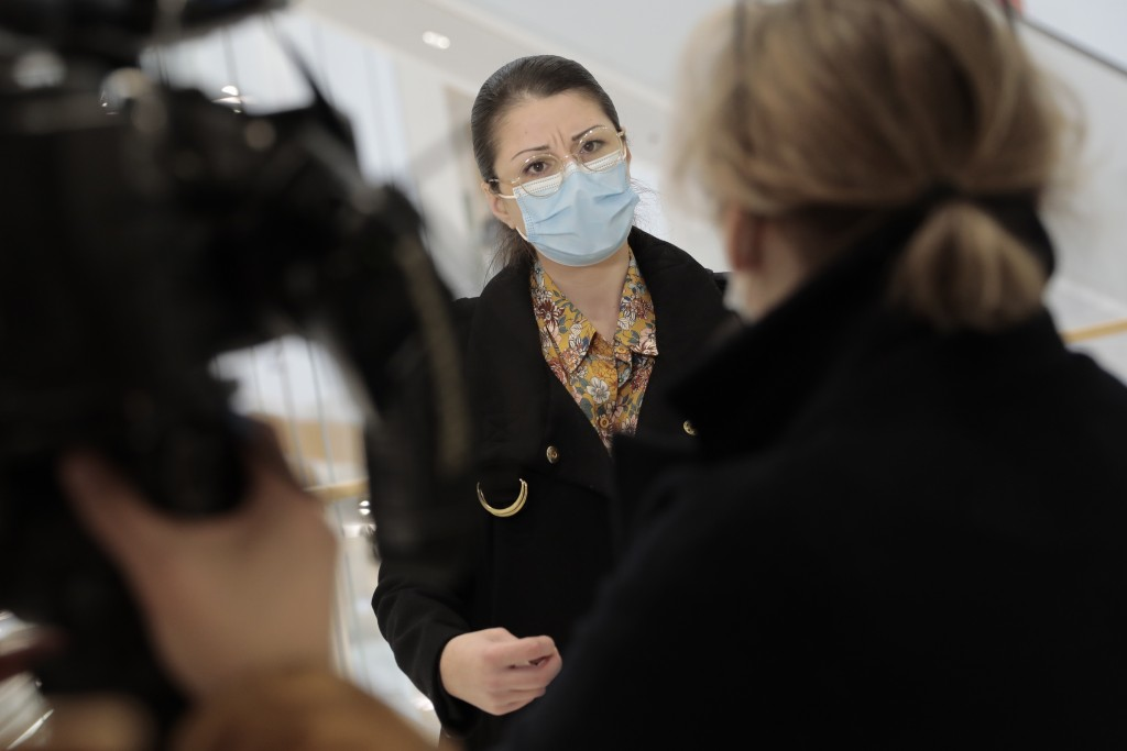Plaintiff Sabrina Deliry answers reporters before the start of a hearing at the Paris Palace of Justice, Wednesday, March 3, 2021. A Paris court holds...