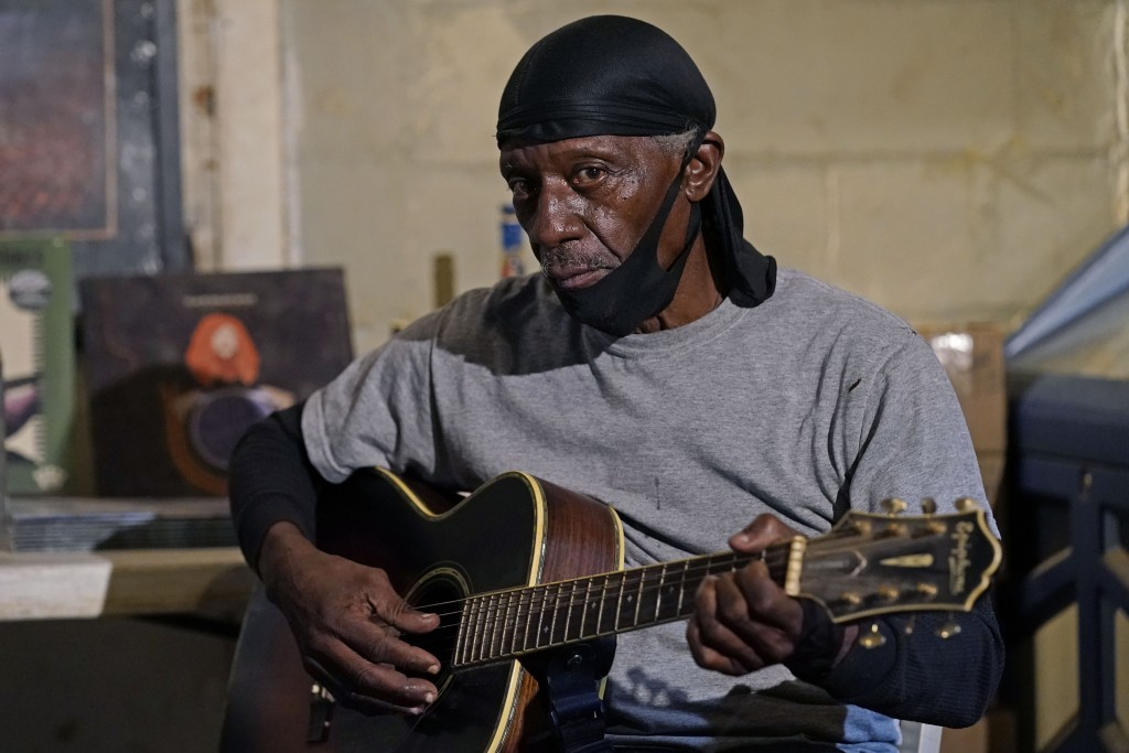 """Bluesman Jimmy """"Duck"""" Holmes plays a quick ditty at the Blue Front Cafe in Bentonia, Miss., Jan. 21, 2021. Holmes' ninth album, """"Cypress Grove,"""" has e..."""