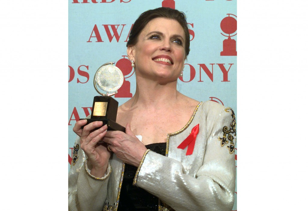 "FILE - Ann Reinking holds her Tony Award for best choreography for the musical ""Chicago"" at the 51st annual Tony Awards on June 1, 1997, in New York. ..."