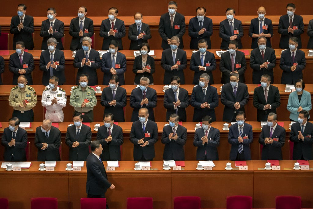 FILE - In this May 28, 2020, file photo, delegates applaud as Chinese President Xi Jinping arrives for the closing session of China's National People'...