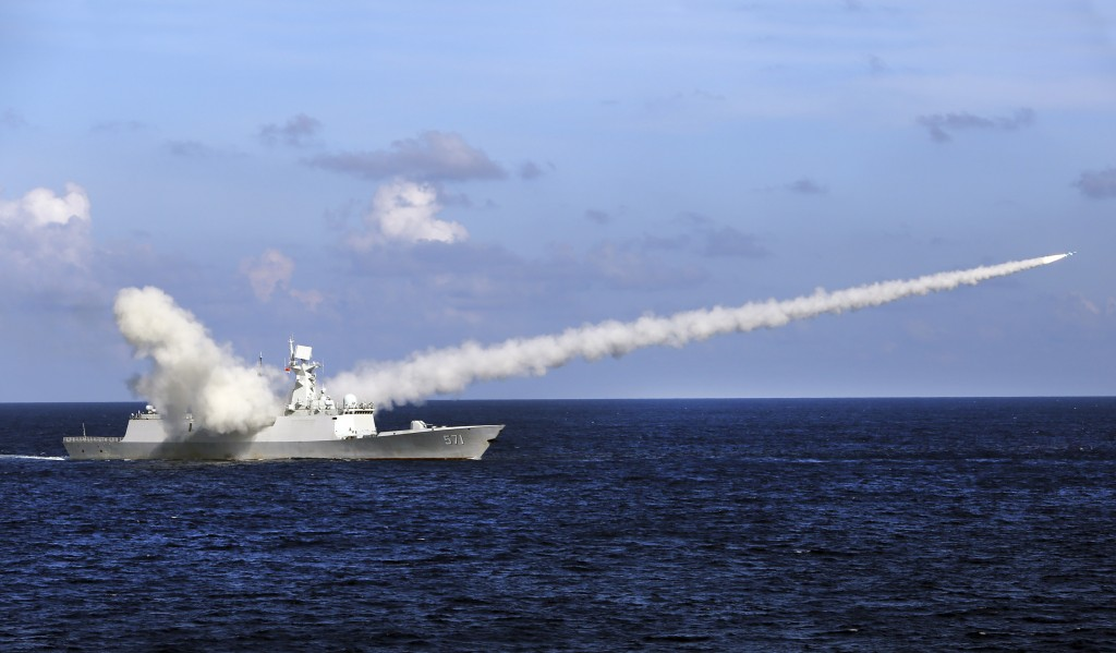 FILE - In this July 8, 2016, file photo released by Xinhua News Agency, Chinese missile frigate Yuncheng launches an anti-ship missile during a milita...