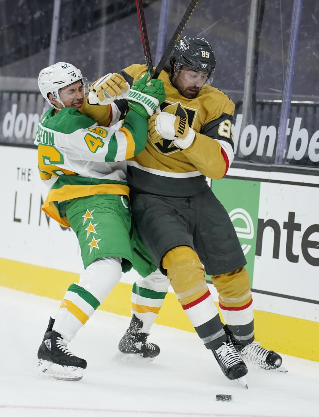 Minnesota Wild defenseman Jared Spurgeon (46) vies for the puck with Vegas Golden Knights right wing Alex Tuch (89) during the second period of an NHL...