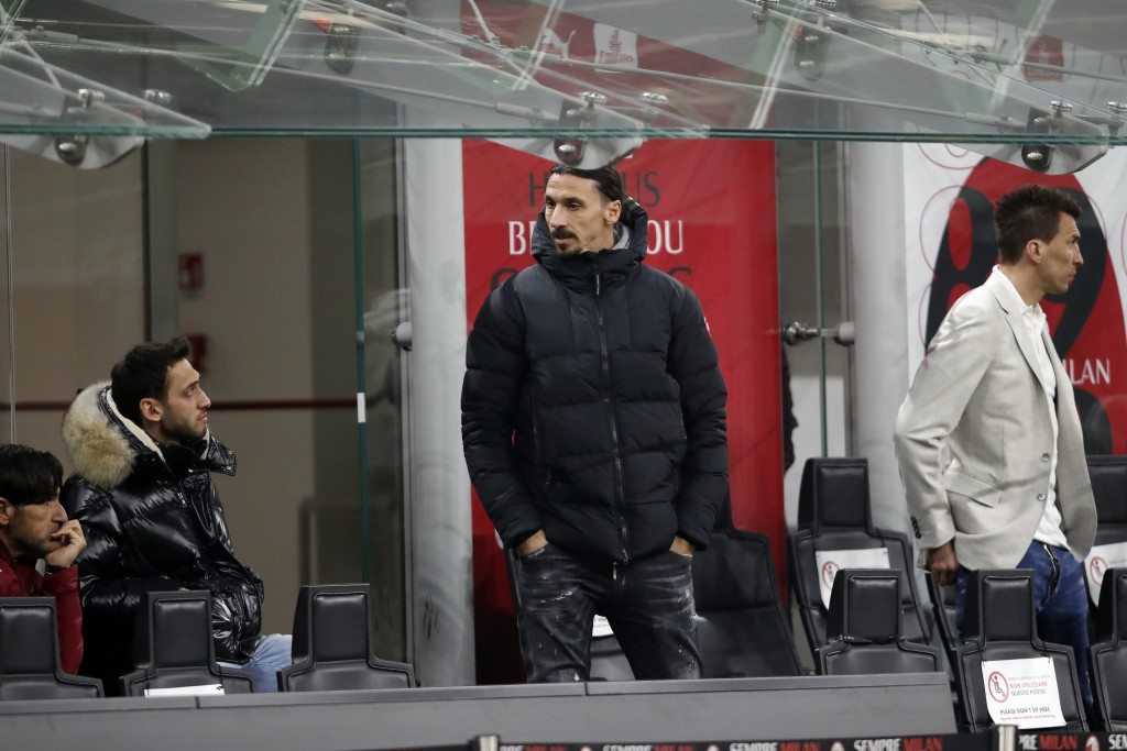 AC Milan forward Zlatan Ibrahimovic, center, stands int he bench area during the Serie A soccer match between AC Milan and Udinese at the San Siro sta...