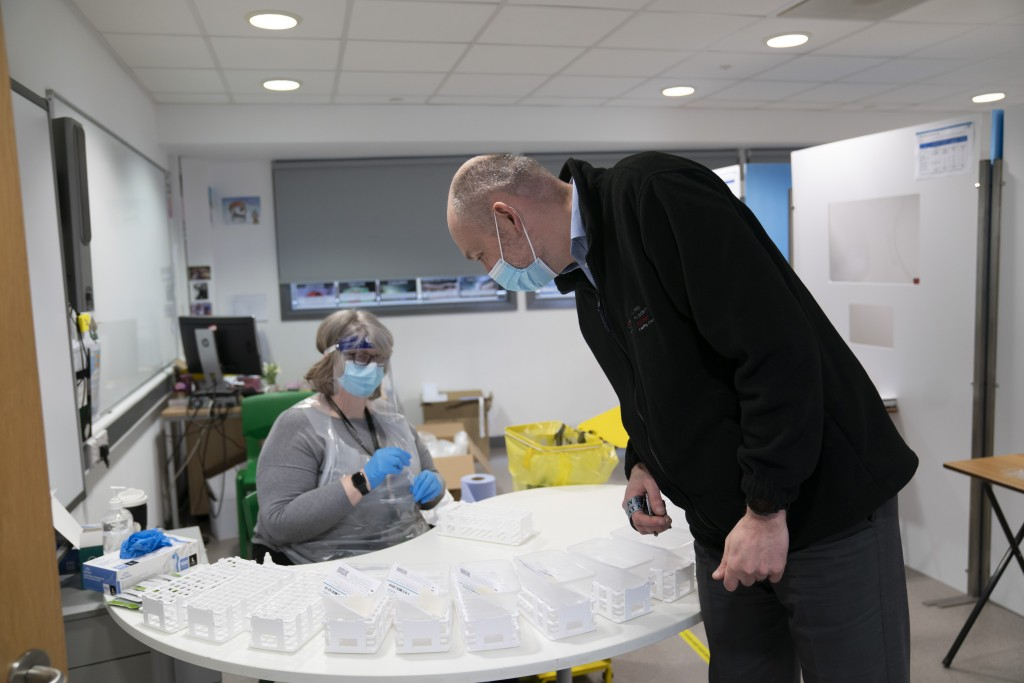 David Waugh, right, principal of Great Academy Ashton walks in a Covid testing area, as the school prepares for its reopening on March 8 after the lat...