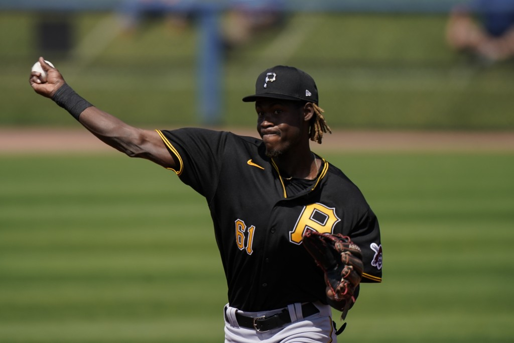 Pittsburgh Pirates shortstop Oneil Cruz throws the ball during a play in the second inning during a spring training baseball game against the Tampa Ba...