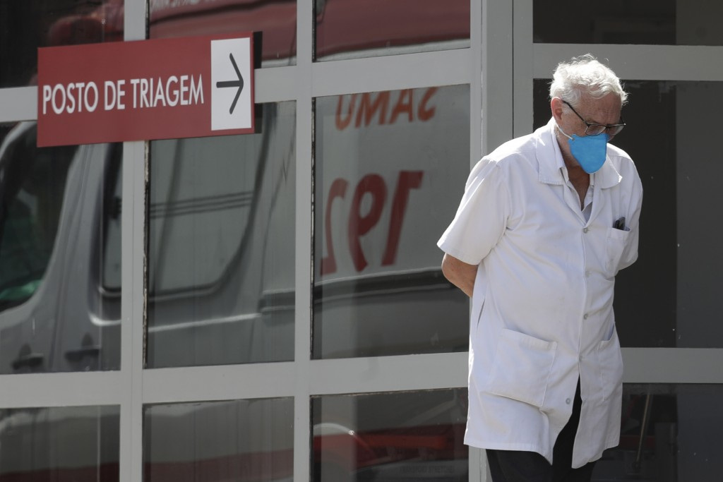 A doctor gets some fresh air as he takes a walk outside the HRAN Hospital in Brasilia, Brazil, Wednesday, March 3, 2021. The number of new COVID-19 ca...